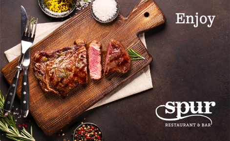 """Gift card image of a steak from the restaurant with the text  """"Enjoy"""" and the Spur Restaurant and & Bar logo"""