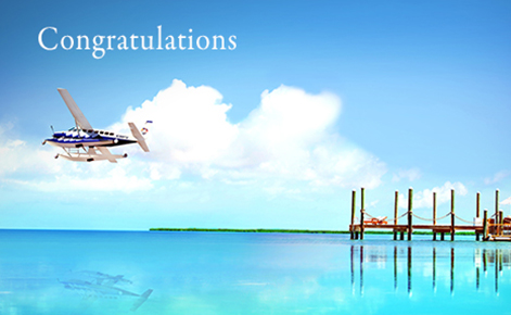 "Gift Card image of seaplane taking off from jetty with the text ""Congratulations"""