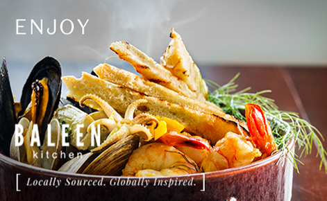 """Gift card image of seafood from the restaurant with the text """"Enjoy"""" and the BALEEN Kitchen logo"""