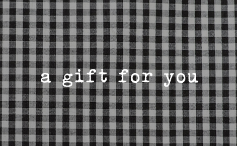 """Gift card image with the text """"A gift for you"""" on a black and white checked background"""
