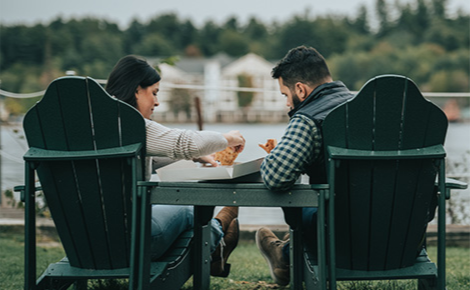 Gift card image of couple eating outside