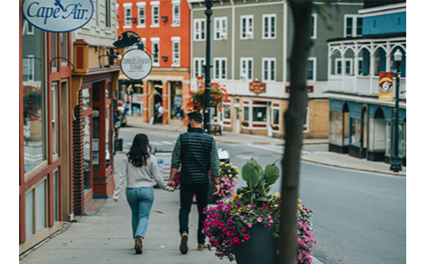 Gift card image of a couple walking through town